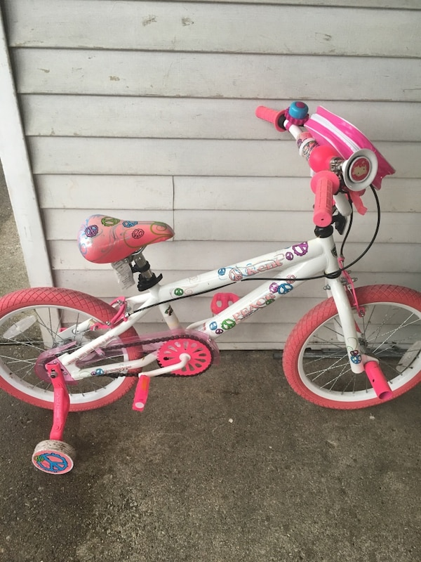 "18"" girls bicycle has front pegs.."