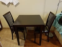 Dining table with foldable sides and 2 chairs Vaughan