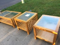 Three beige wooden glass-top coffee tables
