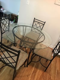 Round clear glass-top table with chairs 387 mi