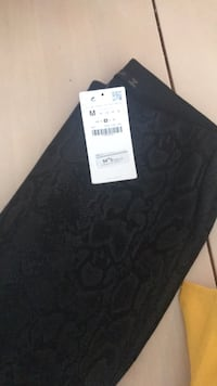 Black fitted snake pattern pants from Zara bought them for $54 Dollard-des-Ormeaux, H9G 1X5