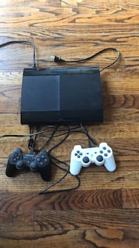 black Sony PS3 super slim console with two controllers Hawthorne, 90250