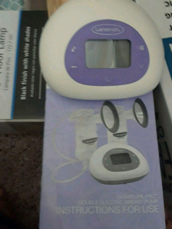 Lansinoh double breast pump with packing not used