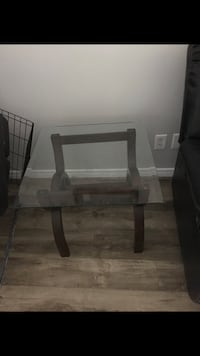 Brown wooden base glass top table Kitchener, N2N 1T4