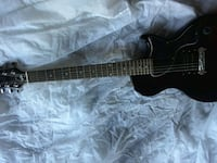 black and brown electric guitar Scarborough, M1S