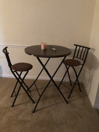 two black metal framed brown wooden stools 656 mi