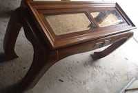 brown wooden framed glass top coffee table Ajax