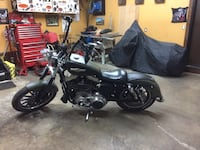 Black and gray cruiser motorcycle 553 km