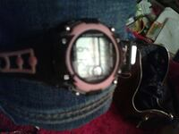 black and pink digital watch