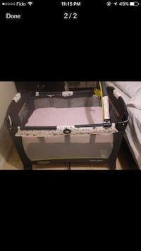 white and black Graco pack n play  Mississauga, L5R 2H4
