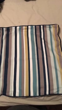 brown, green, white, and yellow striped blanket