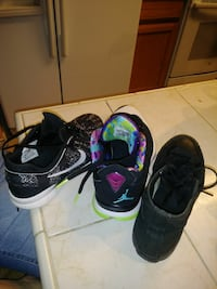 three unpaired basketball shoes