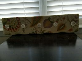 Wall hung fabric covered rack with hooks