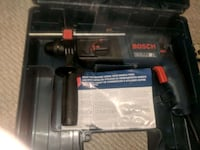 black and blue Bosch corded hammer drill in case