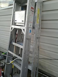 two gray metal a-type ladders