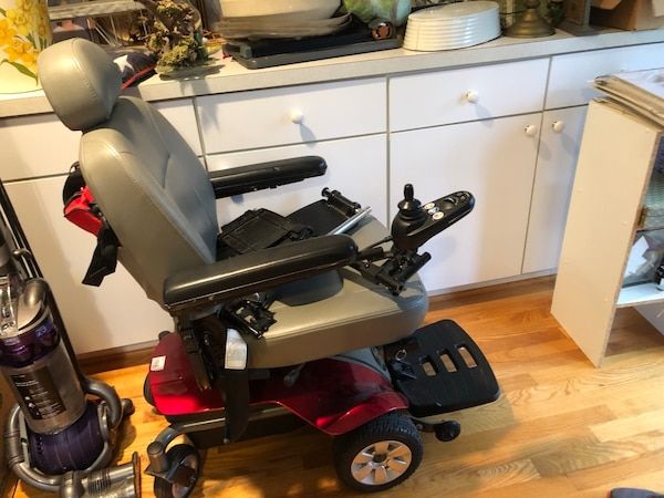 Black and red mobility scooter from the scooter store