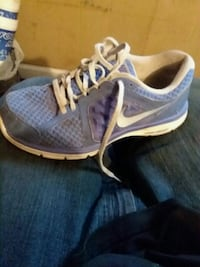 pair of gray-and-white Nike running shoes Cabot, 72023