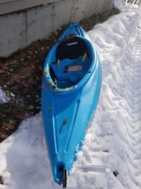 blue and black kayak with paddle 557 mi