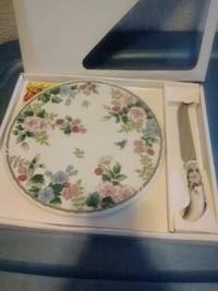 white and green floral ceramic plate and kitchen knife