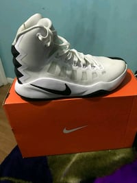 pair of white-and-black Nike basketball shoes Houston, 77040