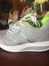 pair of gray-and-green Nike running shoes Toronto, M9C 5J5