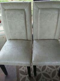 two gray fabric padded chairs
