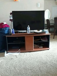 brown wooden TV stand with flat screen TV Alexandria, 22306