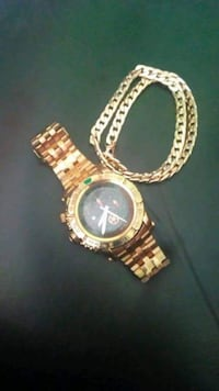 round gold analog watch with gold link bracelet ASHBURN