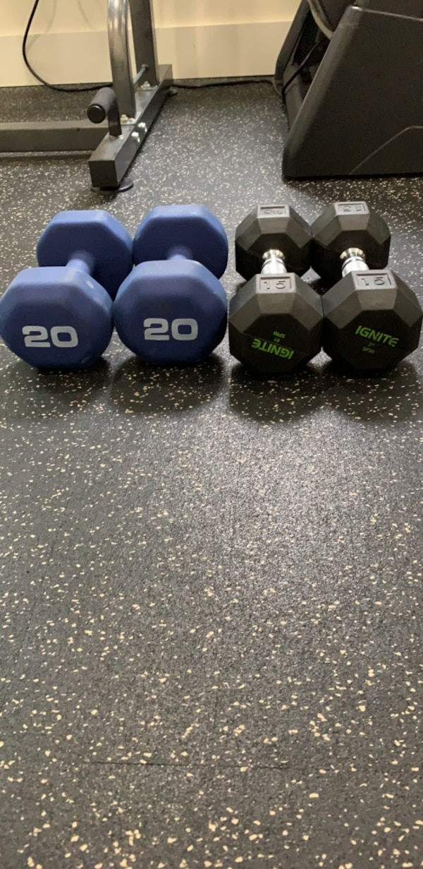 Four assorted color fixed weight dumbbells