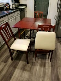 TV trays/ Table with 3 folding chairs.   65 km