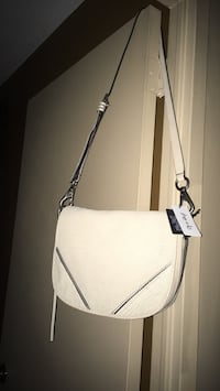 New cream leather bag tag still on paid 228 Oakville, L6K 1Y8