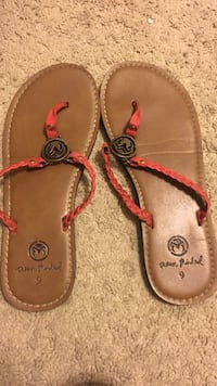 Pair of brown leather t-strap sandals