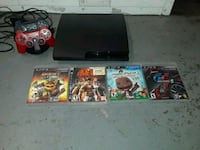 black Sony PS3 slim console with controllers and game cases Long Beach, 90802