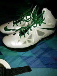 pair of white-and-green Nike basketball shoes Lower Brule, 57548