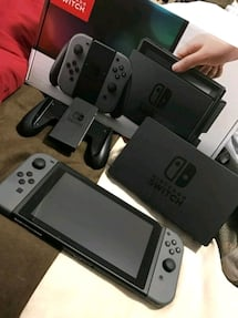 New Nintendo Switch, red joycons and game bundle