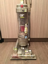 Black and gray hoover upright vacuum cleaner