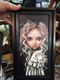 brown wooden framed painting of woman Edmonton, T5P 0P3