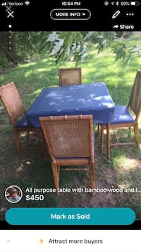 Bamboo table with blue and white leather cover. Seven Hills, 44131