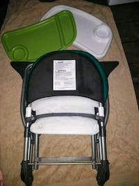 Full size portable high chair..w easy cleanup tray 803 mi