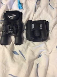two black Tasco binoculars 1620 mi