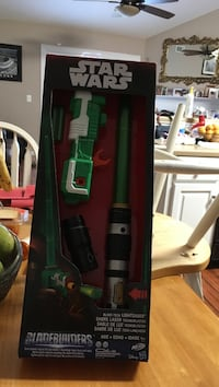 Black and green stick vacuum cleaner
