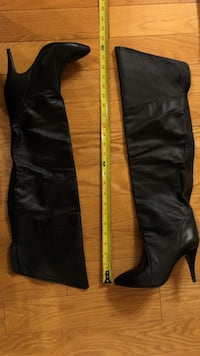pair of black leather knee high boots