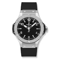 round silver-colored analog watch with black strap Montréal, H4H 2E8
