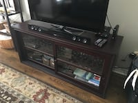 black wooden TV stand with flat screen television Toronto, M3C 4C1