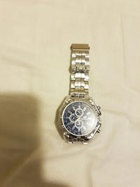 round silver chronograph watch with link bracelet  Calgary, T2A 3K8
