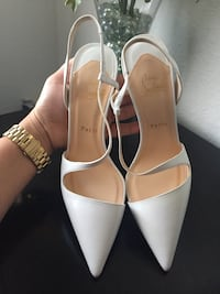 pair of white leather open toe ankle strap heels Orlando, 32809