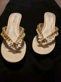 Guess white wedge shoe. .size 7 Vaughan