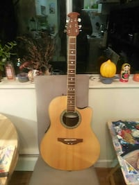 brown cutaway acoustic guitar New Westminster, V3M