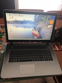 black and gray laptop computer Laval, H7W 3Y7