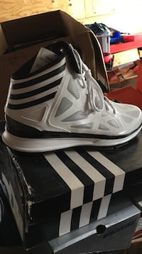 pair of white-and-black Adidas sneakers St. Louis, 63116